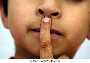 Silence Please - A kid placing his hands on his lips