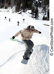 Snowboard jump - Teenager jumping high on a snowboard at the...
