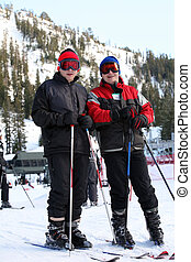 Family skiing - Father and son at the ski resort