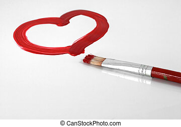 Valentine - A red painted heart with paintbrush on white