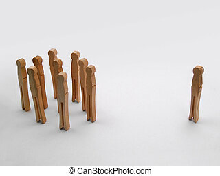 Shunned - One clothespin standing alone outside the group