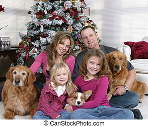 Another Family Christmas - smiling family and dogs sitting...