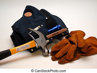 tool belt and gloves - close-up of tool belt and work gloves