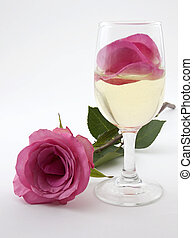 Rose Petal Drink 2 - Photo of a glass of champagne with rose...
