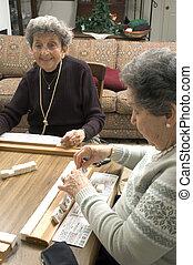 playing mah-jong - happy woman playing mah-jong with friends...