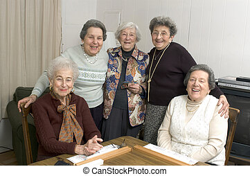 senior woman at the game table - group of happy senior women...