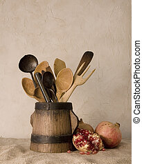 Pomegranates and cutlery - Still life; old wood and metal...