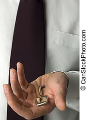 key - business man holding key close up shoot