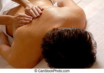 Salt glow - salt massage given by a therapist in a spa