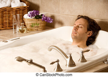 Man in a bath - male client in an aroma bath at a spa