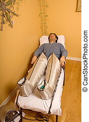 Pressotherapy - man in a spa with pressotherapy legs on