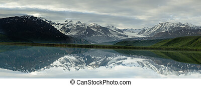 panoramic landscape reflected in lake - In the water of...