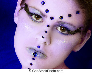 Royal Beauty - Beautiful young woman in blue beads and face...
