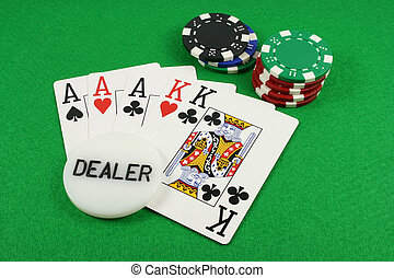 Full House with a dealer chip on top on a green background