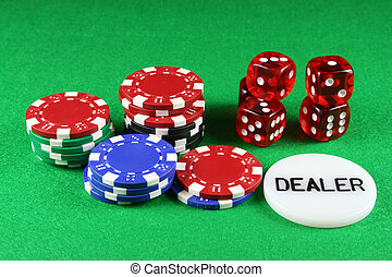 Poker Chips and 5 Dice - Poker chips and 5 dice on a green...