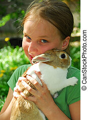 Gril with bunny - Portrait of a young girl holding a bunny...