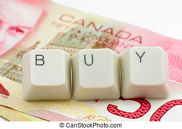 canadian dollar. concept of online shopping - letter keys...