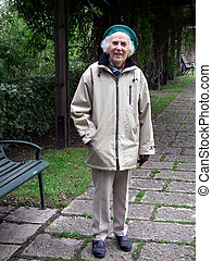 My Favourite Place - senior woman standing beside bench in...