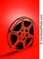 16mm movie reel on a red background