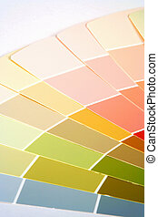 Paint Swatches - Paint samples fanned out on a white...