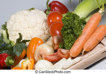 fresh produce - fresh vegetables on cutting board tilted