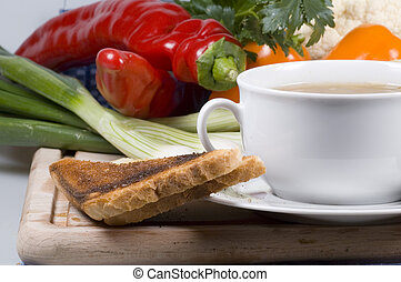 super lunch - A bowl of fresh vegetable soup with toast on...