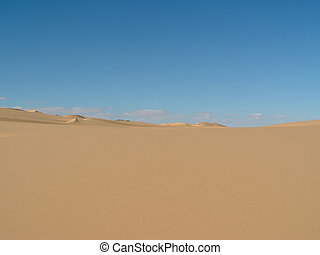Sahara desert in Egypt - Sand dunes and blue sky with some...