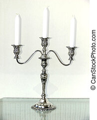 Candle holder 501 - A silver three arm candle holder with...