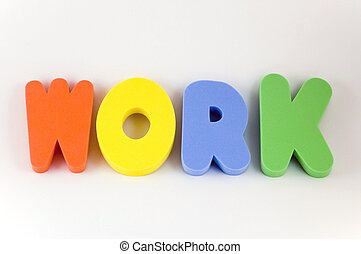 Work - The word work written in large childrens foam letters...