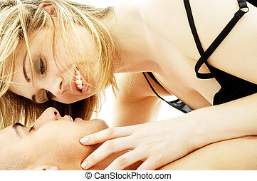 couple foreplay - intimate color image of sensual couple...