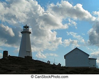 Lighthouse and cloud 3 - a lighthouse in front of a cloudy...