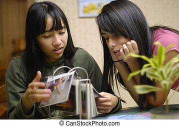 Sisters Look at Pics