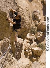 Climbing-joshua tree - A rock climber in Joshua Tree...