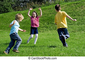 fun - running children on a meadow