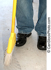 Cleaning - Man showing jeans and boots and bottom of yellow...