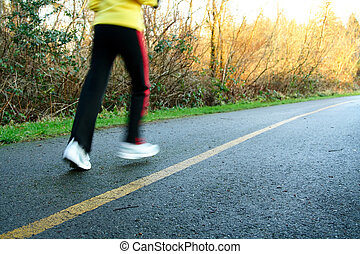Afternoon run - A woman exercising and running in the...