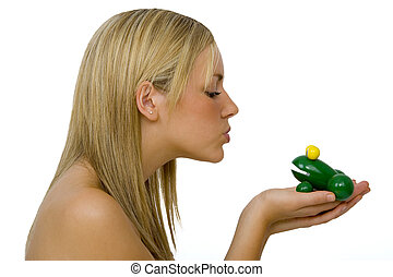 Kissing Another Frog - A gorgeous young blond woman kissing...