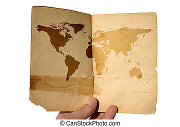 hand holding aged world map