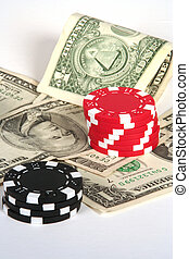 Casinos - Stacks of chips  on a pile of money