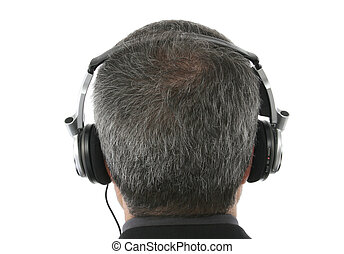 Headphones - Fourty something man wearing headphone. Back...