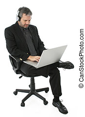 Business Man with Laptop and Headphones - Fourty something...