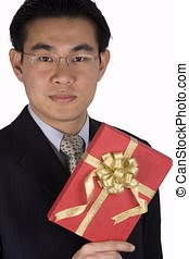 Chinese Businessman holding Present - A chinese businessman...