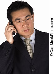 On The Phone - Asian business man holding a mobile phone.