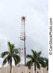 Radio Tower - Radio tower on building with palm trees