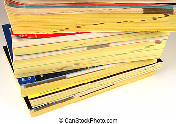 Phone Books - Stack of phone directories on a white...