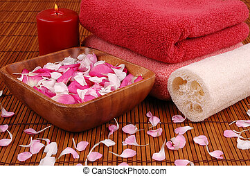 Spa - Towels, candle, carnation and rose petals, and bath...
