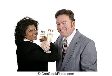Champagne for Two - An attractive couple in business suits...