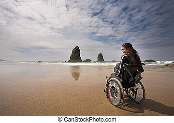 Adventure - Beautiful young woman in a wheel chair visiting...