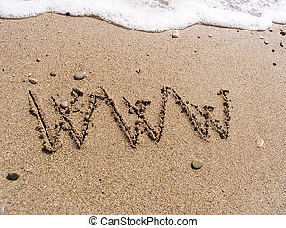 WWW on sand - Inscription on sea sand WWW