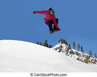 Snowboard jumping - Teenager jumping high on a snowboard at...